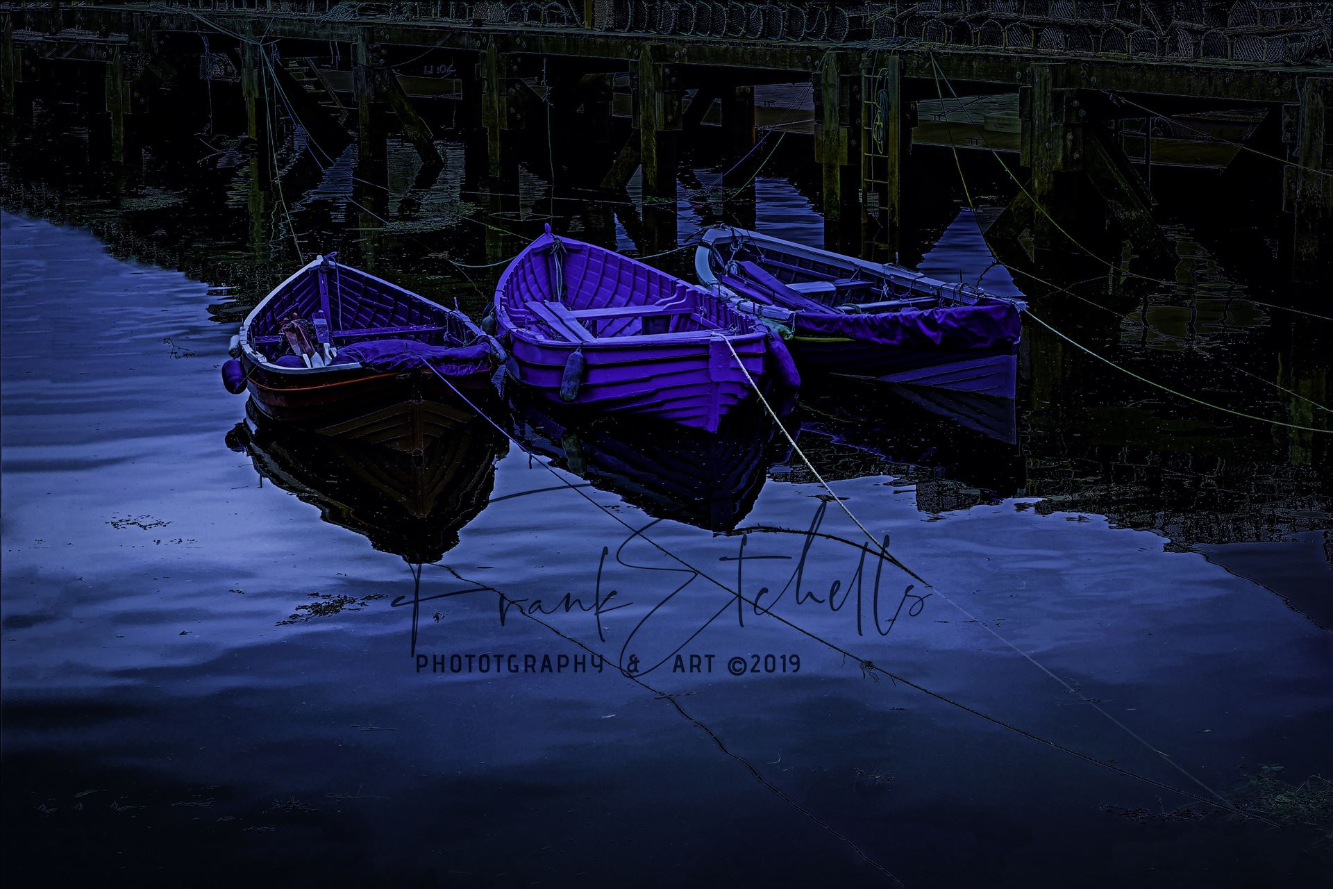 Boats by Moonlight, Edit - ''Digital Art conversion: On a trip to Whitby in Yorkshire in 2012 and a walk through the town brought us to the harbour quay side and these small tethered boats. Edit to give a 'moonlit' effect... by Frank Etchells Photography