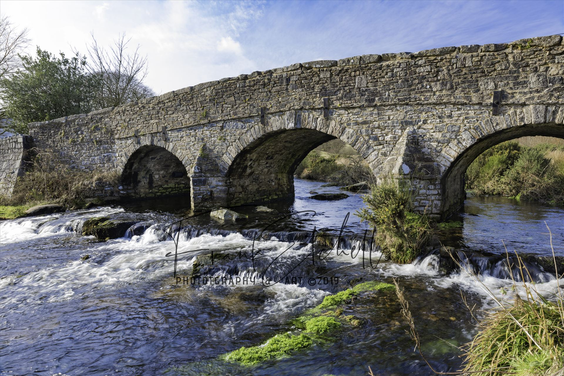 East Dart River Bridge 4 - A view of the bridge over the East Dart River at Postbridge, Dartmoor National Park from the side of the