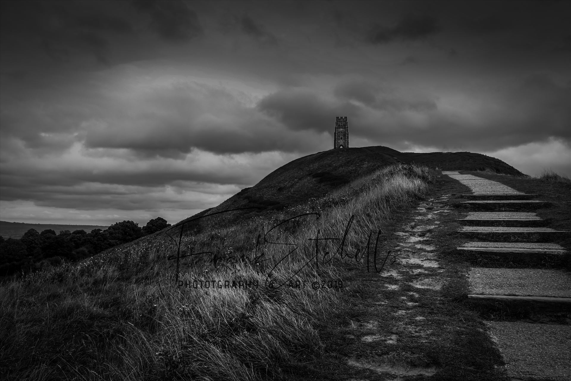Up To The Tor - A trip to Glastonbury Abbey and the famous Tor. Walking up towards the Tor from Glastonbury brings you to the meandering 'stairway steps' that wrap their way round the mound to make your way to the Tor and the magnificent views from the top. 24/09/2016 by Frank Etchells Photography