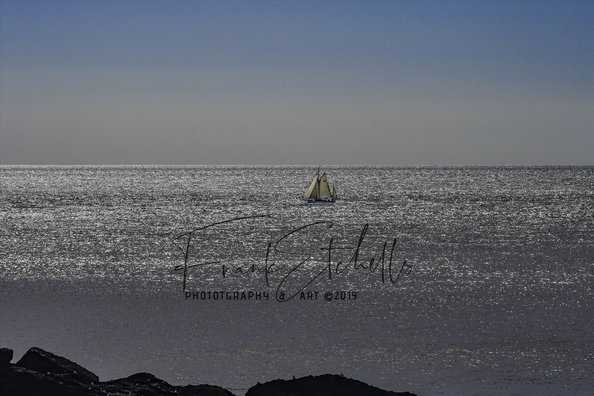 Hazy Days Sailing 3 - Walking the South West Coastal path at The Lizard, Cornwall on a glorious day in August 2017, This Ketch was sailing on the shimmery sea with a blue cloudless sky and haze on the horizon. Gin & Tonic, Rum & Lime Time.
