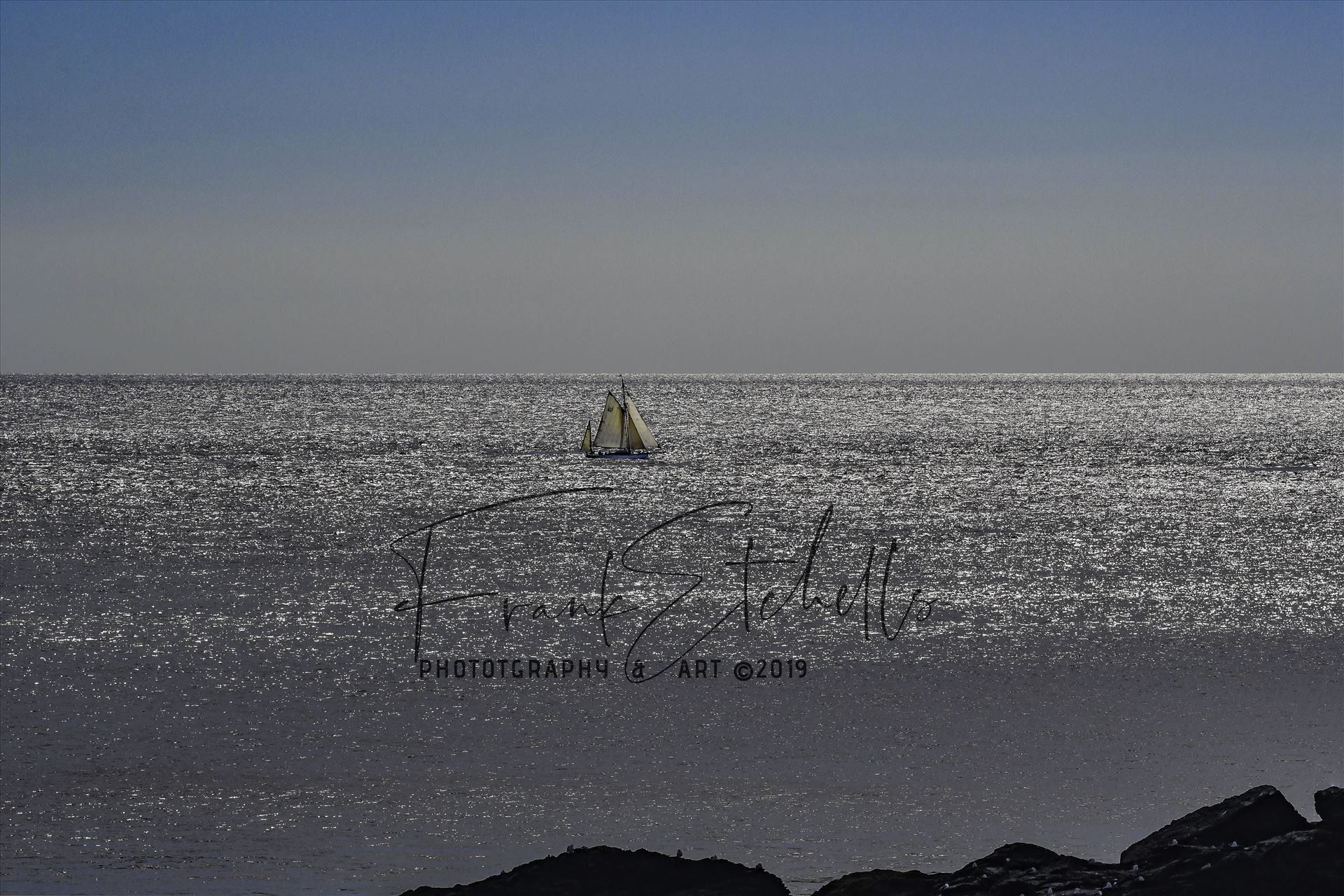 Hazy Days Sailing 2 - Walking the South West Coastal path at The Lizard, Cornwall on a glorious day in August 2017, This Ketch was sailing on the shimmery sea with a blue cloudless sky and haze on the horizon. Gin & Tonic, Rum & Lime Time.