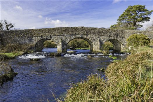 "A view of the bridge over the East Dart River at Postbridge, Dartmoor National Park from the pathway at the side of the ""Clapper Bridge"", on a cold but dry February day visit."