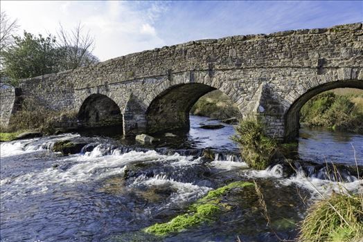 "A view of the bridge over the East Dart River at Postbridge, Dartmoor National Park from the side of the ""Clapper Bridge"", on a cold but dry February day visit."