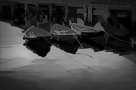 "On a trip to Whitby in Yorkshire in 2012 and a walk through the town brought us to the harbour quay side and these small tethered boats, their bows and ropes reflected in the sea water and lobster pots neatly in stacks on the walkway. A ""Vector"" Edit of t"